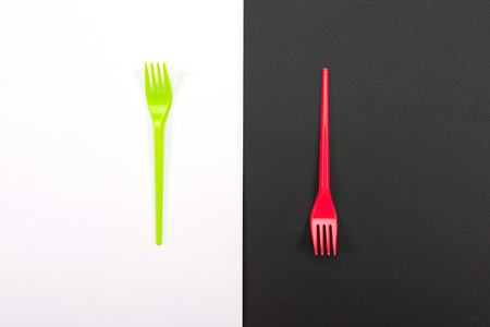 Bright green and red set of forks isolated on black and white background. Mock-up Stock Photo