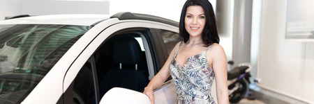 Charming customer brunet buying a new car in dealeship center