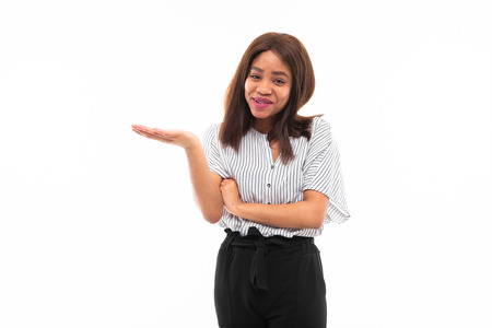 emotional african-american young girl in casual outfit possing and gesticulates hands isolated on mockup background Stock fotó