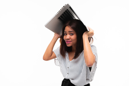shy african-american young girl on casual outfit covered with silver laptop isolated on mockup background Фото со стока - 122955061