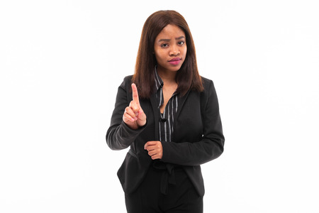 emotive beautiful african-american young girl in black office suit possing isolated on mockup background Фото со стока - 122955100