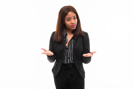 emotive beautiful african-american young girl in black office suit possing isolated on mockup background Фото со стока - 122955104