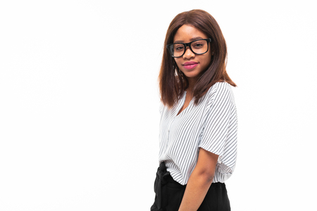 african-american young girl possing in casual outfit and glasses isolated on mockup background Фото со стока - 122955135