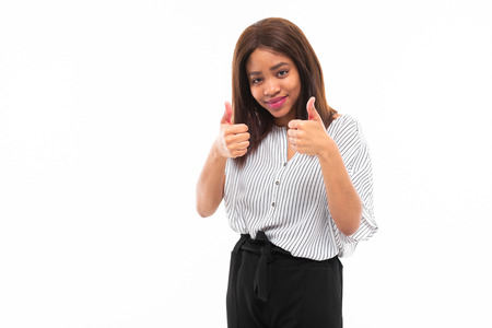 emotional african-american young girl in casual outfit possing and gesticulates hands isolated on mockup background Фото со стока - 122955141