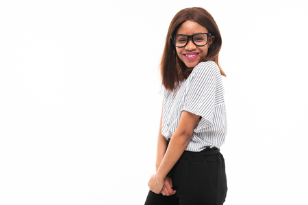 african-american young girl possing in casual outfit and glasses isolated on mockup background Фото со стока - 122955146