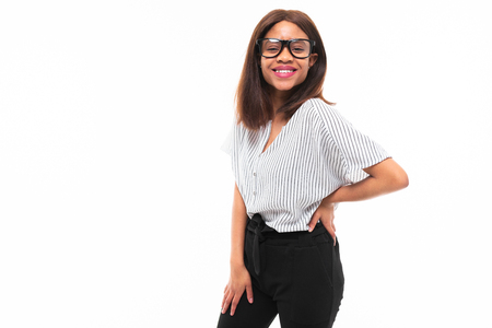 african-american young girl possing in casual outfit and glasses isolated on mockup background Фото со стока
