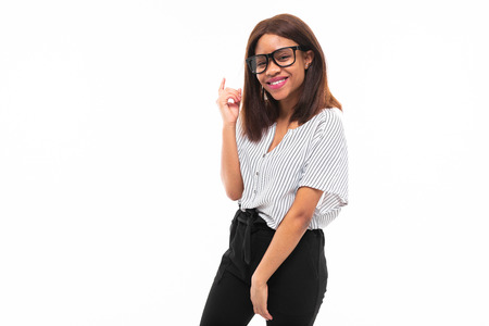 african-american young girl possing in casual outfit and glasses isolated on mockup background Фото со стока - 122955354
