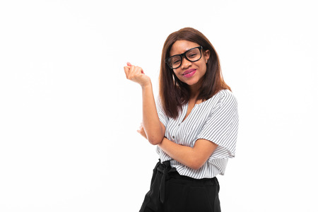 african-american young girl possing in casual outfit and glasses isolated on mockup background Фото со стока - 122955355