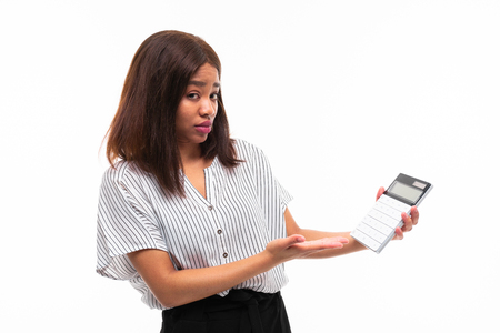 smilling african-american young girl on casual outfit explain smth wit calculator in her hand isolated on mockup background