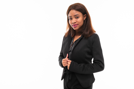 emotional african-american young girl in black suit possing isolated on mockup background Stockfoto