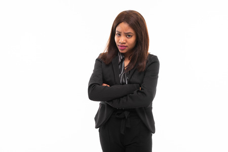 emotive beautiful african-american young girl in black office suit possing isolated on mockup background Фото со стока
