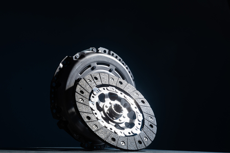 spare part for a car on a dark background, clutch disc,