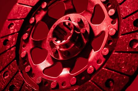 Shot of modern new spare parts for car in red artificial lighting made from different foreshortenings