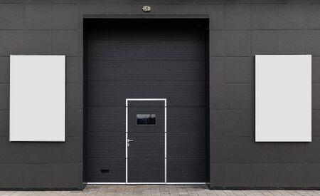 warehouse gate, advertising space. dark background white banner Foto de archivo - 129194305