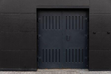 industrial door in the building, black steel Foto de archivo - 129194307