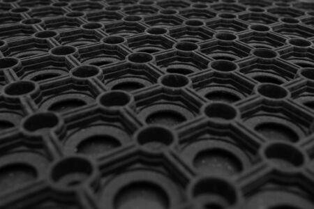 A closeup of a black rubber doormat Stock fotó