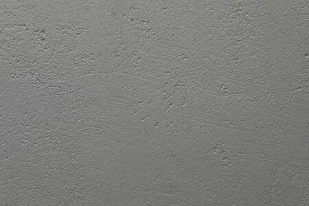 An unsmooth painted grey-blue beton wall Фото со стока