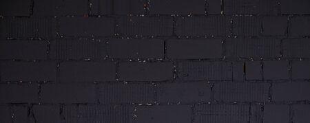 Panorama of wall of rough dark brick