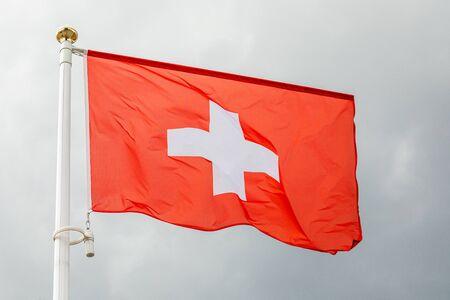 Swiss flag waving in the wind in sky