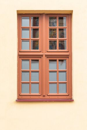 Closeup of wooden window of church in a whaite wall Stok Fotoğraf
