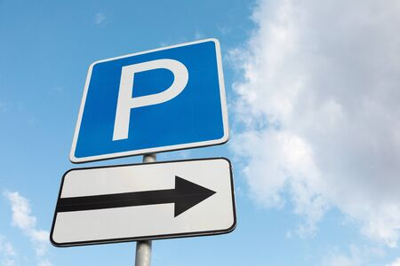 Closeup of Roadsign Parking lot on right against sky 스톡 콘텐츠