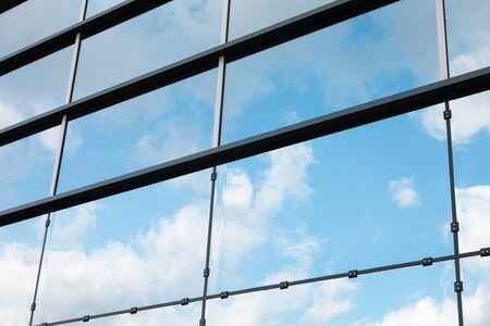 Diagonal view of glass wall, reflecting sky, of modern skyscraper in Minsk, Belarus Stok Fotoğraf