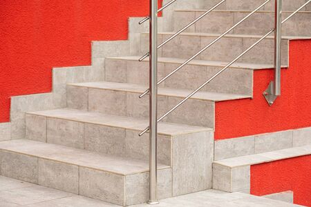 Close-up of street tiled staircase against fiesta color wall. Photo with depth of field. Stockfoto - 129196159