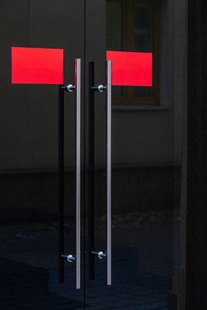 Black glass door with two red blank signs and metal handles Stok Fotoğraf