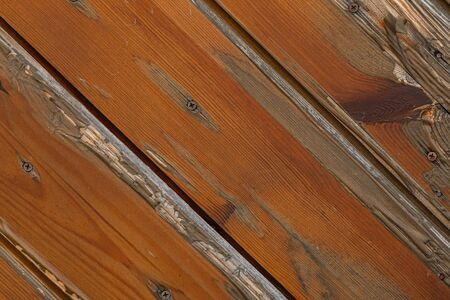 Close-up of wooden wall with a nail in it