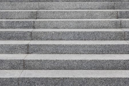 Straight view of grey cobblestone steps, background with grunge texture Stock Photo
