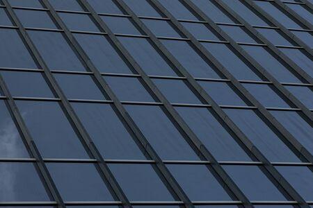 Angular view of modern glass business centre wall Stockfoto