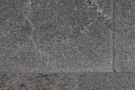 Close-up of grey pavement covered in granite tile