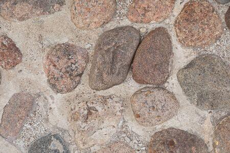 Pebblestone pavement, background with grunge texture, cobble Stockfoto - 129199702