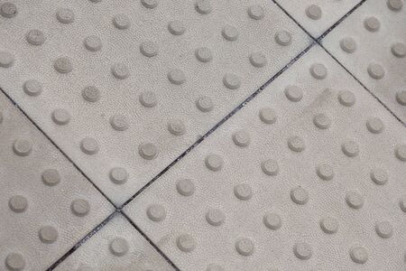 Gray tactile paving for blind people, background with grunge texture Stok Fotoğraf