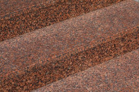 Close-up of dark red granite tile steps outdoors Stock fotó