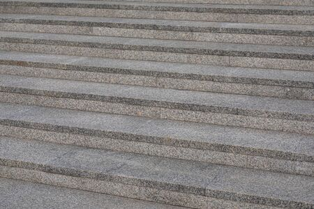 Close-up of grey granite tile steps outdoors