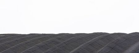 Panoram view of graphite fabrics with cell pattern on white background.