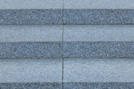 Front view of grey granite steps on city street. Photo with depth of field