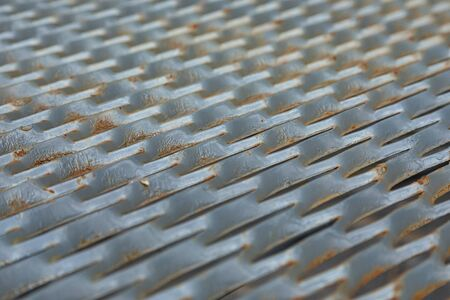 Wide angle view closeup of metal mesh with corrosion