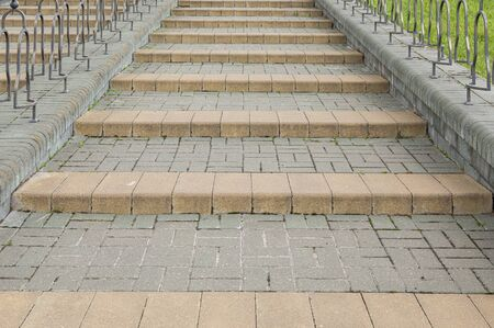Closeup of grey street tiled stairs going up