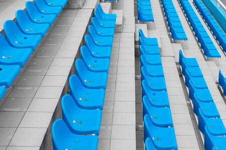 Descending rows of bright spectator seats in sport facility