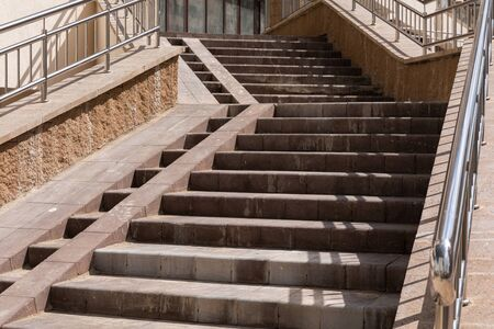 High concrete paved stairs leading to apartment entrance