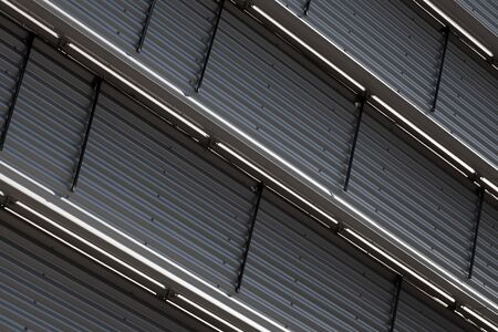 Close-up of ground view of corrugated wall with metal level dividers