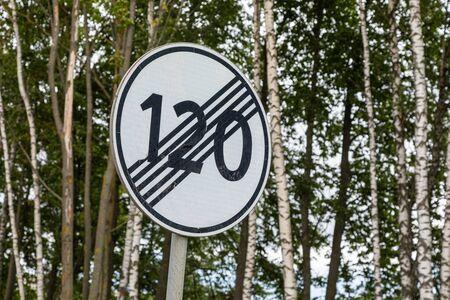 roadsign End of speed limitation one hundred twenty km zone against trees Reklamní fotografie