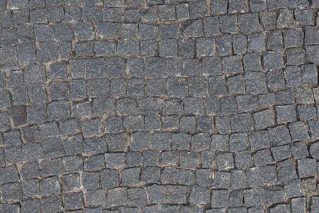 Erhöhte Ansicht des grauen Steinpflasters, Hintergrund mit Schmutzbeschaffenheit