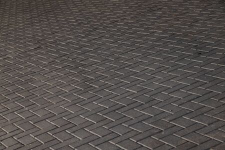 Wide angle view of grey paving flagstone. Photo with depth of field