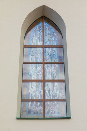 Stained-glass arched window of cathedral in Minsk, Belarus