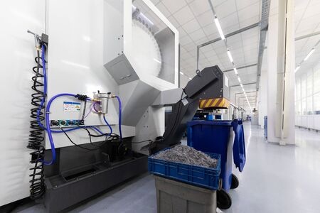 Inside of factory unit with new modern computerized equipment and mechanisms and box with swarf. Photo with depth of field Stock Photo