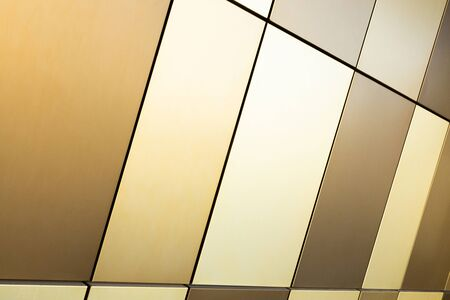 Beige, soft brown and golden multicolored tile of different sizes for interior and exterior design, diagonal view, pattern background