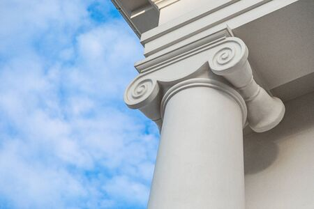 Architectural column of classicism style with whirl